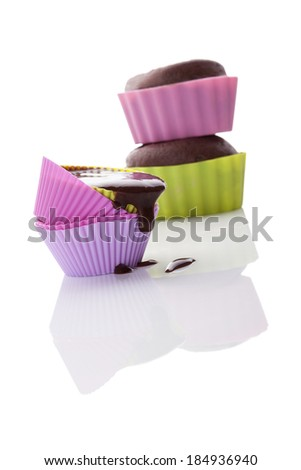 Cupcake mixture dropping from baking form isolated on white background. Making cupcakes. - stock photo