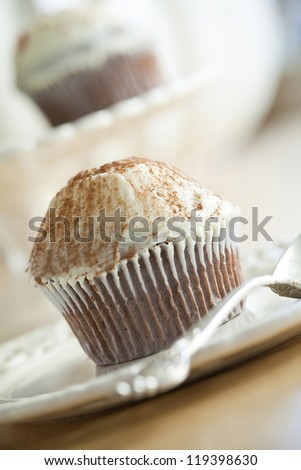 Cupcake on a plate. - stock photo