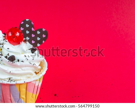Cupcake on a red background.