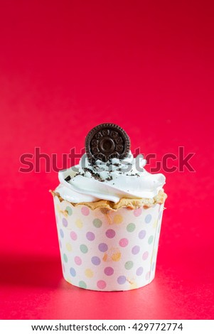 Cupcake on a red background.,cupcake. birthday cake. Vertical cupcake background. Food cupcake. - stock photo