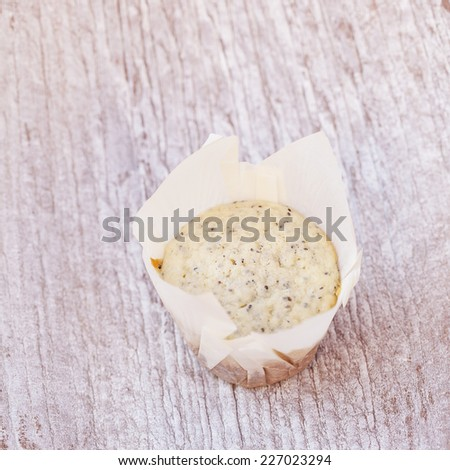 cupcake on wood textured background