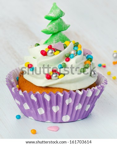 Cupcake on wooden table. Selective focus