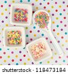 cupcake sprinkles on a dotted background - stock photo