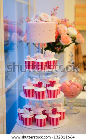 Cupcake stand many colorful cupcakes. - stock photo