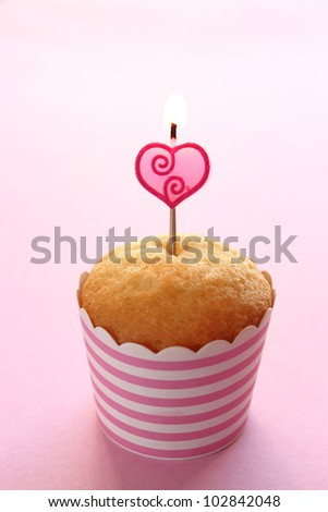 cupcake with a candle - stock photo