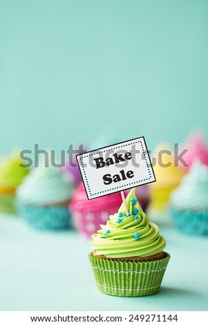 Cupcake with Bake Sale sign - stock photo