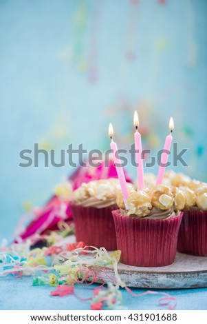cupcake with birthday candle, copy space background