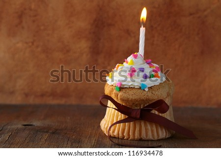 cupcake with candle and  cream for birthday - stock photo