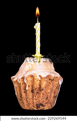 cupcake with candle isolated on black background - stock photo