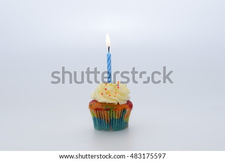 Cupcake with candle on white background