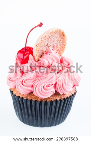 Cupcake with cherry close up - stock photo