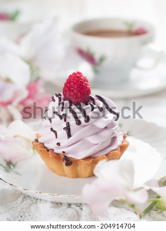 Cupcake with chocolate and raspberry, selective focus