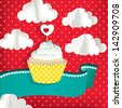 Cupcake with clouds and red background - stock photo