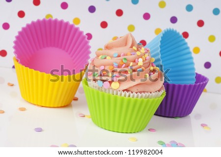 cupcake with empty cups in rainbow colors