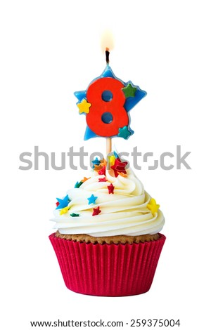 Cupcake with number eight candle - stock photo