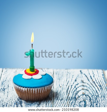 Cupcake with number one on a blue background. birthday greetings - stock photo