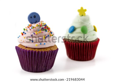 cupcake with pink cream isolated and sprinkles on white background