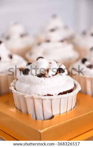 Cupcake with topping chip chocolate with blurred background
