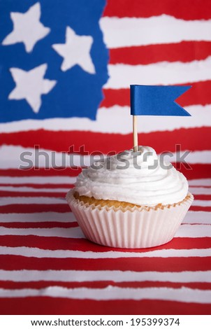 Cupcake with White Topping on an American Flag Background - stock photo