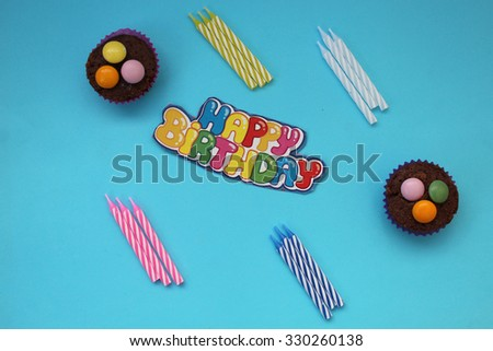 Cupcakes and candles - happy birthday card - stock photo