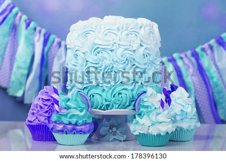 Cupcakes and rosette cake in party setting - stock photo