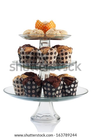cupcakes and scones with three tiered tray isolated on white. - stock photo
