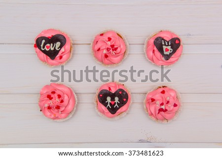 cupcakes covered in pink and cream hearts for Valentine
