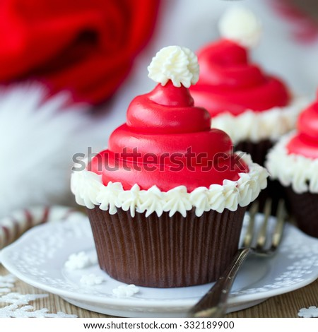 Cupcakes decorated with buttercream santa hats - stock photo