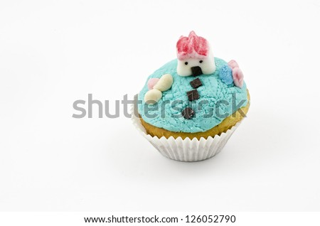 cupcakes decorated with figures made from fondant