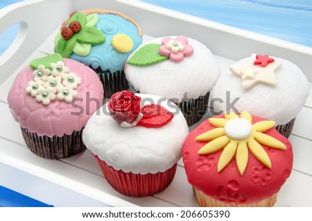 Cupcakes decorated with fondant - stock photo