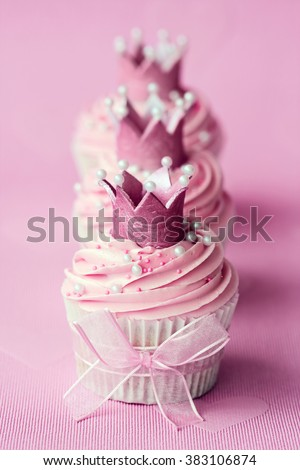 Cupcakes decorated with sugar crowns - stock photo