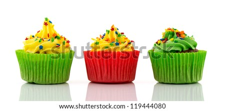 cupcakes in green and red with little stars as confetti