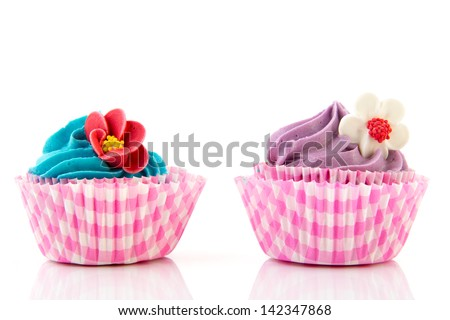 cupcakes in purple and pink with butter cream