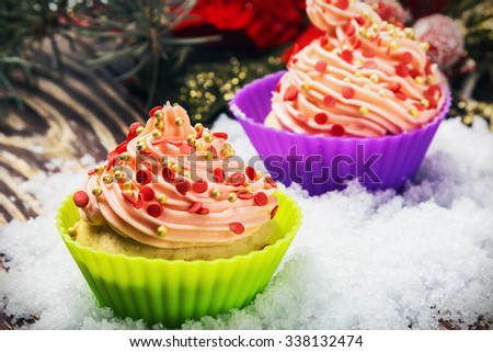 cupcakes in the snow on a wooden table