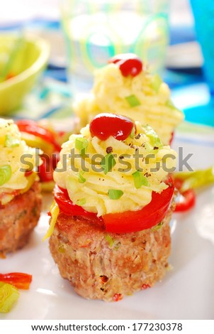 cupcakes made from baked minced meat,potato puree and vegetables for dinner - stock photo