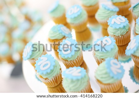 Cupcakes on a mirror, with number 10 on them - stock photo