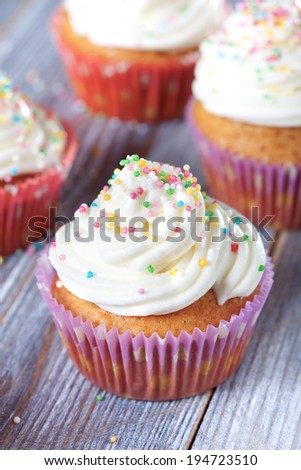 cupcakes on wooden table, selective focus