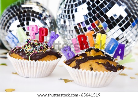 Cupcakes spelling out happy birthday - stock photo