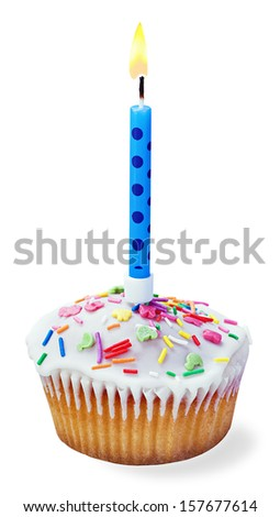 cupcakes with a birthday candle isolated on a white background - stock photo