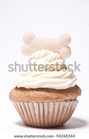 Cupcakes with a dog Bone on top - stock photo