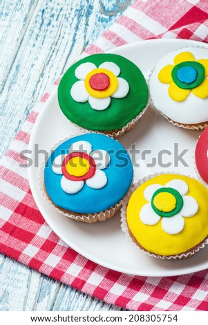 cupcakes with a floral pattern on a wooden table