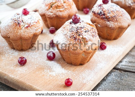 Cupcakes with black currant jam and some berries around - stock photo
