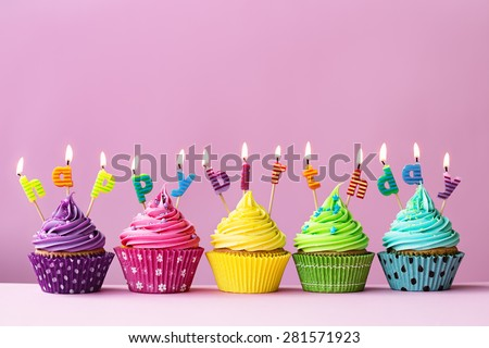 "Cupcakes with candles spelling the words ""happy birthday"""