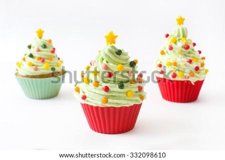 Cupcakes with Christmas tree shape - stock photo
