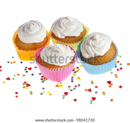 cupcakes with colorful sprinkles on white background - stock photo