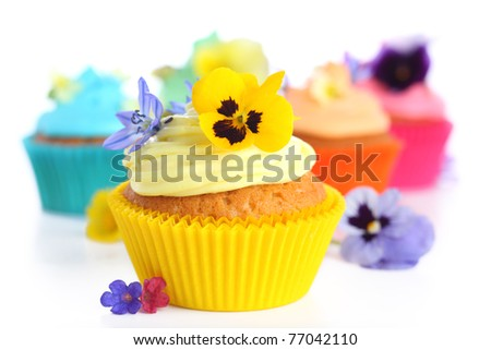 cupcakes with cream and decorated with violets