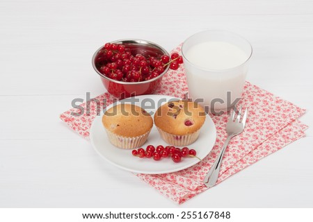 Cupcakes With Fresh Red currant. White Painted Table. - stock photo