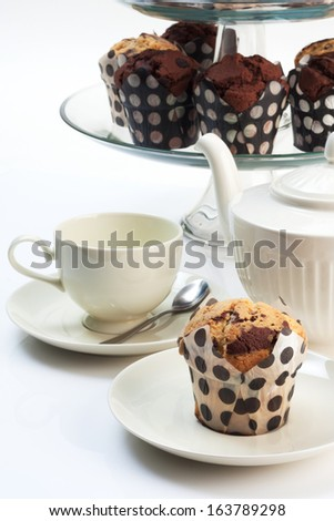 cupcakes with three tiered tray and tea set. - stock photo