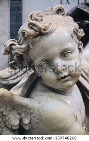 Cupid from holy water font in St. Peter''s Basilica, Rome - stock photo