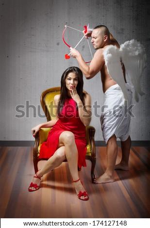 Cupid hit with arrow  - stock photo